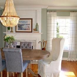 Dining room update including custom fireplace design, lighting, furniture, custom window treatments | design